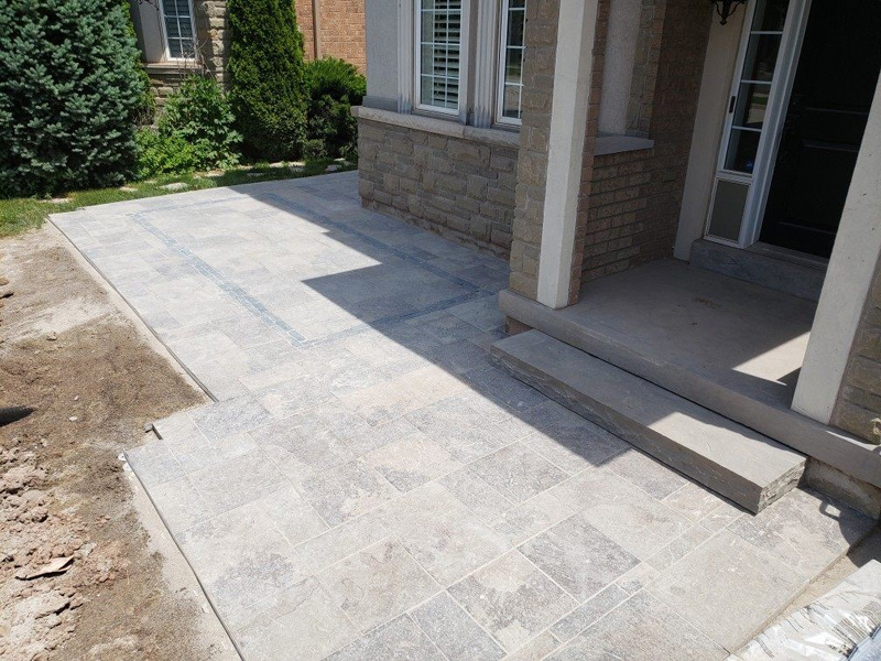 installation of outdoor concrete tile in front of the house